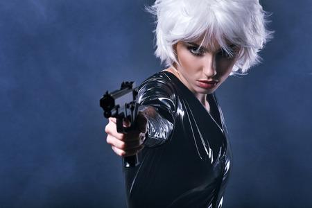 holding gun: beautiful sexy girl holding gun . smoke background