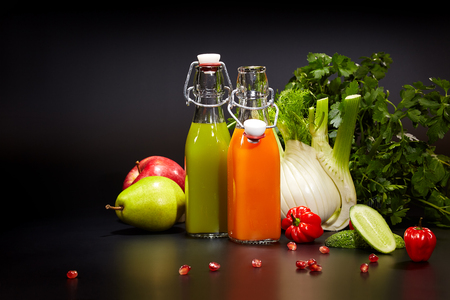 antioxidant: healthy vegetable juices for refreshment and as an antioxidant . Black background Stock Photo