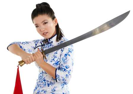 female model: young beautiful Japanese woman in kimono looking aggressively at camera and holding katana sword Stock Photo