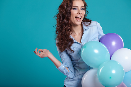 Young pretty woman with colored balloons 스톡 콘텐츠