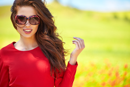 glasses model: outdoor photo of beautiful sexy girl  in elegant dress posing in summer field of red poppies
