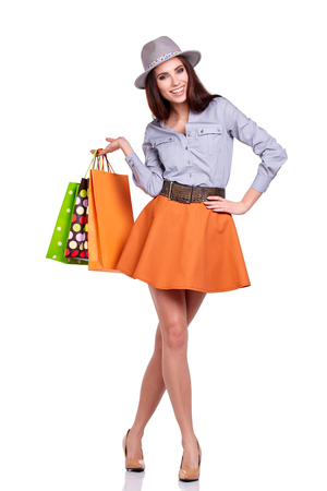 Happy girl hold shopping bag.