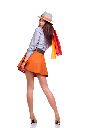 purchases: woman with shopping bags. Studio shoot