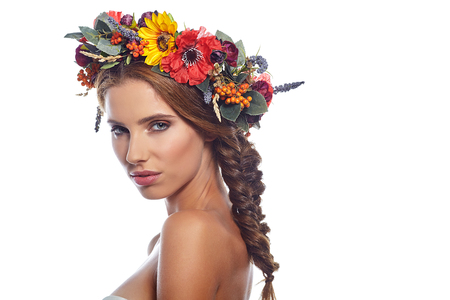 long hairs: young beautiful woman portrait with wreath of flowers studio shot