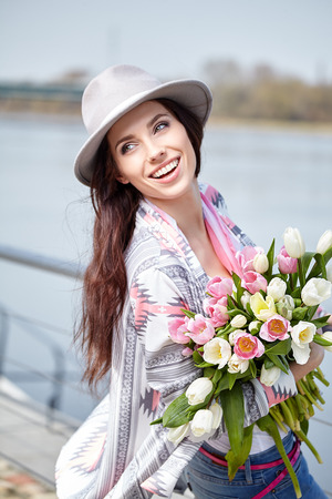 Caucasian woman: Woman with tulips. Beautiful woman with flowers.