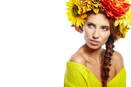 beautiful background: Beautiful Young Woman with Summer  Flowers. Long Permed Curly Hair and Fashion Makeup. Beauty Girl with Flowers Hairstyle.