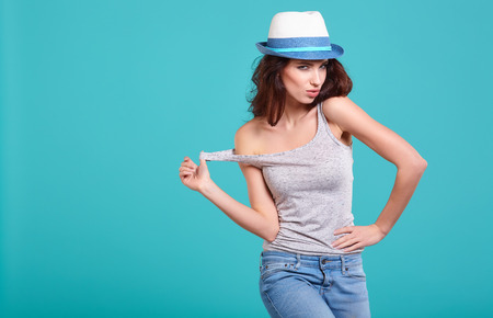 fashion clothing: Young Woman with spring hat against blue background