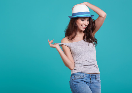 fashion model: Woman with spring hat against blue background