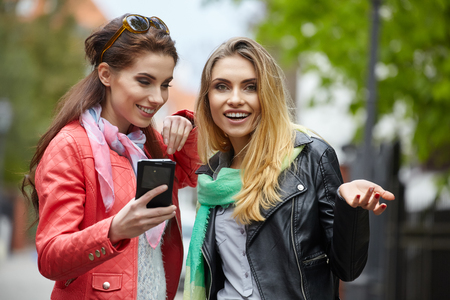 women friendship: Friends making selfie. Two beautiful young women making selfie