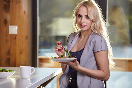 blond girl: Happy Woman Having Healthy Breakfast. Healthy food
