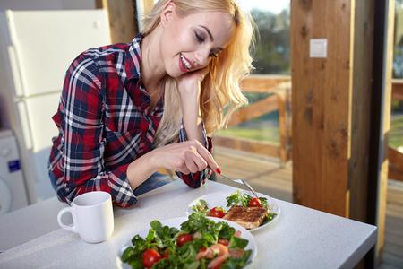 eating food: Happy Woman Having Healthy Breakfast. Healthy food