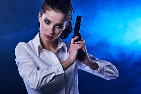 sexy pictures: beautiful sexy girl holding gun . smoke background