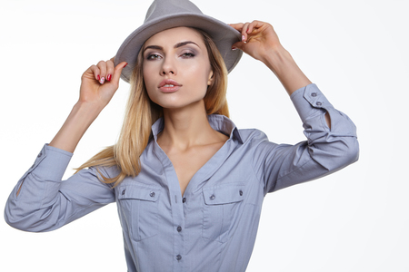 portrait studio: fashion studio portrait of beautiful sensual woman with blond hair with evening makeup with hat