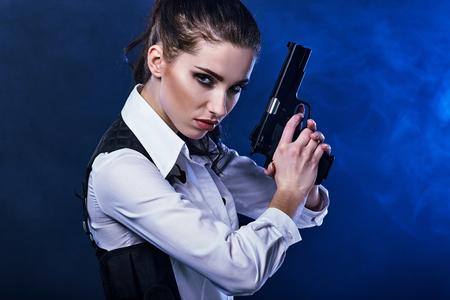 gunshot: special tactics woman holding up her weapon