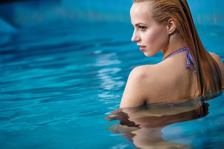 wellness center: Closeup of beautiful woman in pool Stock Photo
