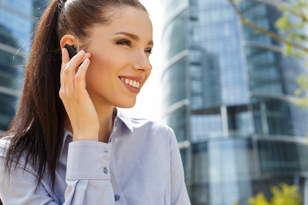 bluetooth: Businesswoman with  headset phone Stock Photo