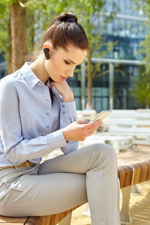 telephoning: Businesswoman with  headset phone Stock Photo