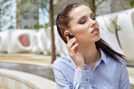 bluetooth: Businesswoman with Bluetooth headset phone