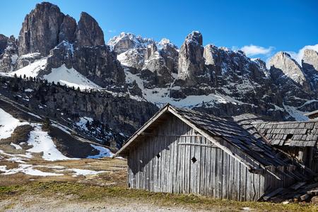 ski lodge: An Alpine meadow with  old wooden farmhouse, Dolomites, Italian Alps Stock Photo