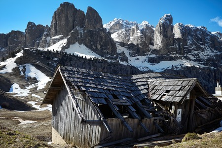 foothills: An Alpine meadow with  old wooden farmhouse, Dolomites, Italian Alps Stock Photo