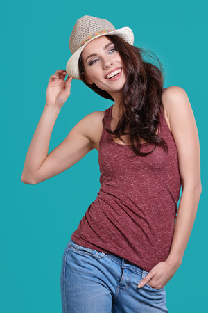 casual fashion: Young Woman with spring hat against blue background