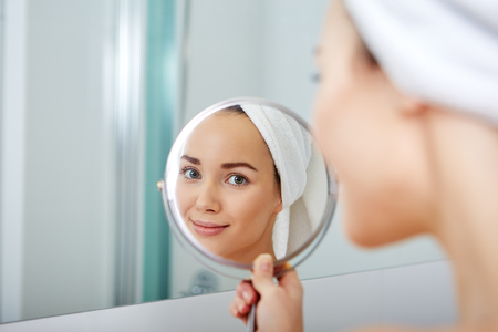 foolish: Young Woman in the Bathroom. Home concept Stock Photo