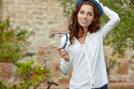 satisfaction: Pretty cheerful woman in the Tuscany garden