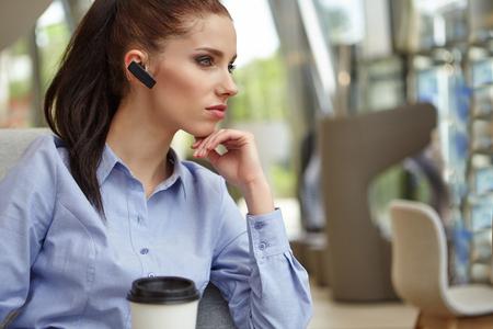 millennial: Businesswoman drinking coffee  tea in a coffee shop