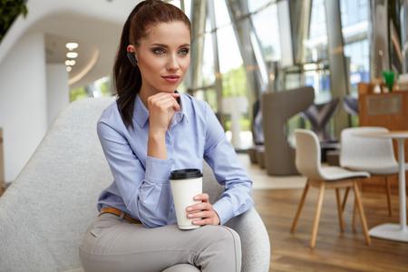 executive women: Businesswoman drinking coffee  tea in a coffee shop