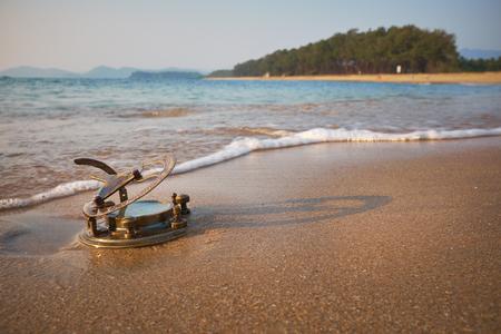 sundial: Vintage Sundial on a tropical beach Stock Photo