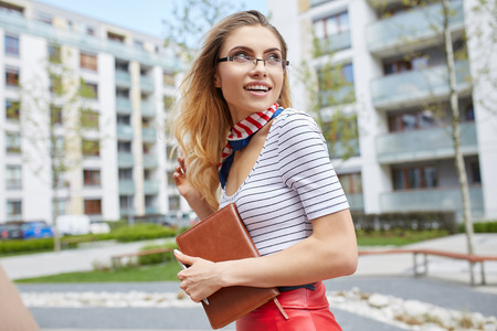 woman  glasses: Young attractive happy student woman wearing  glasses holding a briefcase Stock Photo