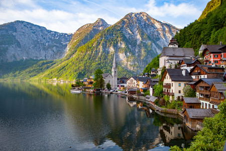 Scenic picture-postcard view of famous Hallstatt mountain village with Hallstatter See in the Austrian Alps in beautiful golden morning light in fall, region of Salzkammergut, Austria Stock Photo