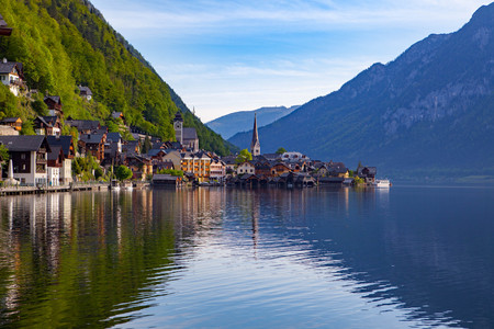 see: Scenic picture-postcard view of famous Hallstatt mountain village with Hallstatter See in the Austrian Alps in beautiful golden morning light in fall, region of Salzkammergut, Austria Stock Photo