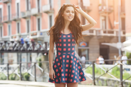 fashion dress: Beautiful fashion woman outdoor on the street of the old town