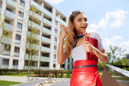 bussines people: Young happy women or student on the property bussines background