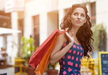 happy shopping: beautiful summer woman goes shopping in the city Stock Photo