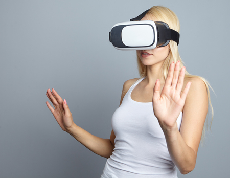 gesticulating: Smile happy woman getting experience using VR-headset glasses of virtual reality at home much gesticulating hands Stock Photo