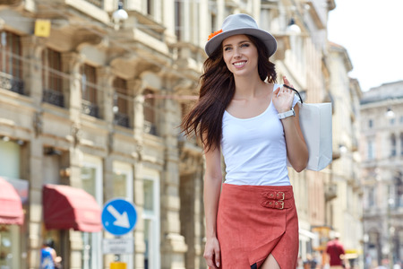 italy street: Young beautiful woman with shopping bags in the city