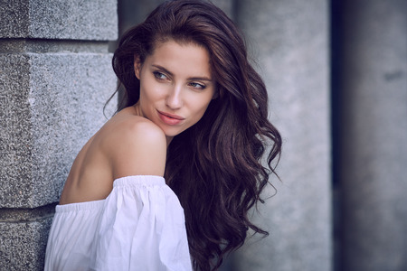 urban fashion: Portrait close up of young beautiful haired woman, on summer scene