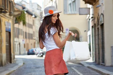 sky scrapers: Beautiful summer woman goes shopping in the city