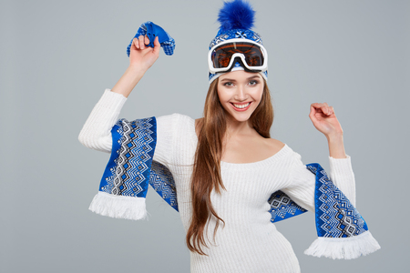 sport clothes: woman in sports thermal body for skiing training ski googles studio shot