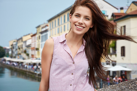 europe map: Pretty young tourist traveling in Milan, Italy Stock Photo