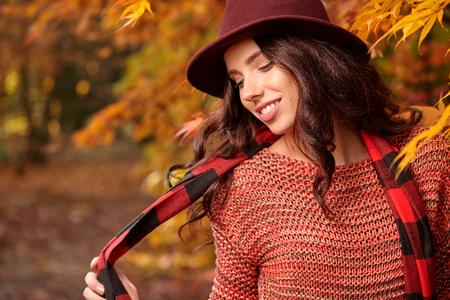 shoe model: Beautiful elegant woman in a park in autumn