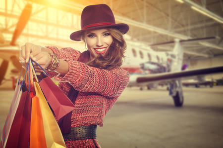 after shopping: Woman after shopping in airport