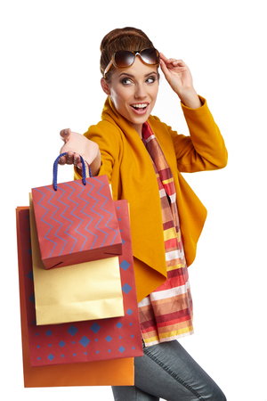 overcoat: Woman wearing autumn overcoat and scarf  holding shopping bag. Stock Photo