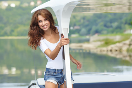 sailboat: Attractive girl sailing on a yacht on summer day