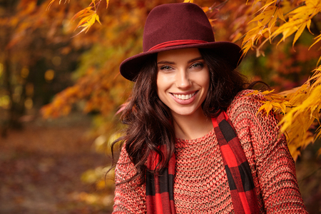 Beautiful elegant woman standing in a park in autumn , Fall concept Stock Photo