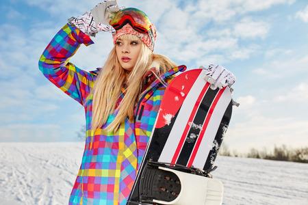 snowboarder: blonde snowboarder girl  on snow Stock Photo