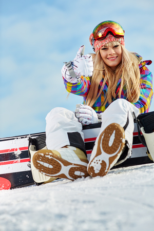 blonde snowboarder girl  on snow Stock Photo
