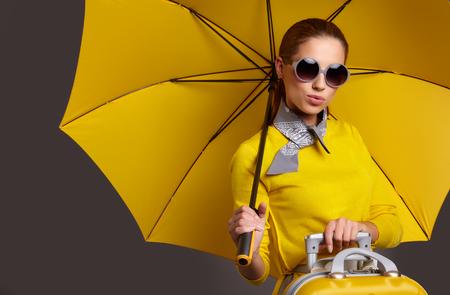beautiful teen: Glamour woman under yellow umbrella Stock Photo